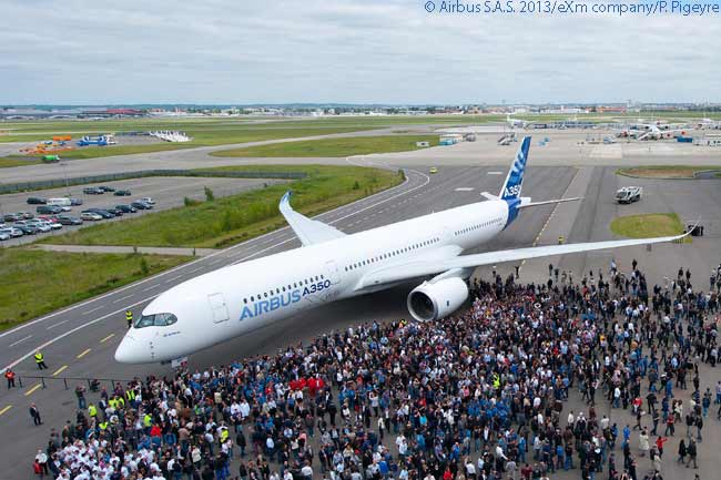After having its engines installed in April 2013 and after passing a subsequent intensive phase of ground vibration tests, the first flight-test Airbus A350 XWB was painted in the company's house colors and was complete by mid-May 2013. Airbus employees crowd round the newly painted aircraft to admire it after it emerges from the paint shop