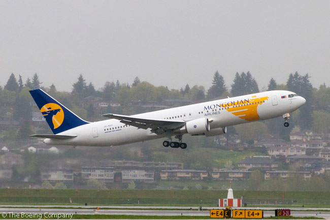 MIAT Mongolian Airlines took delivery on May 13, 2013, of a new Boeing 767-300ER, the first aircraft it had ever ordered directly from the manufacturer. The aircraft is photographed taking off from Boeing Field in Seattle