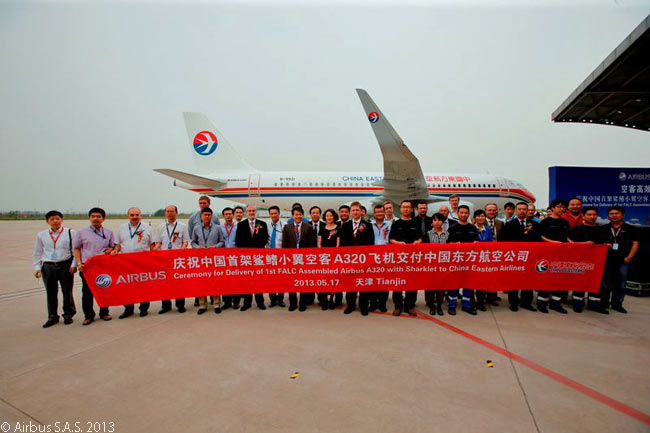 Staff of Airbus and China Eastern Airlines celebrate the delivery of the first Sharklet-equipped Airbus A320 from the Airbus Final Assembly Line China (FALC) in Tianjin. The aircraft was delivered to China Eastern Airlines