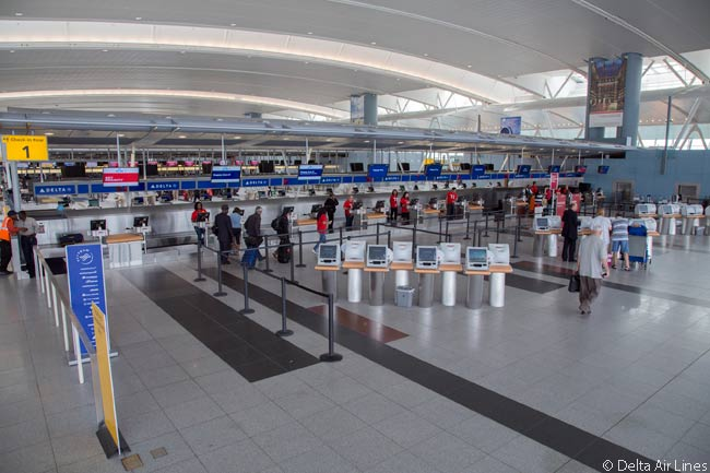 This photograph shows the Delta Air Lines economy class check-in facilities at New York JFK's Terminal 4 Concourse B, which has replaced the carrier's operation at Terminal 3. This was a famous circular terminal building constructed in the 1960s and which originally served as the Pan Am Terminal