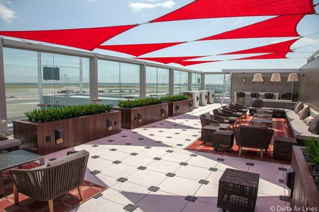 This is the Delta Sky Deck at Delta Sky Club outdoor terrace at New York JFK Terminal 4 Concourse B. The outdoor terrace is Delta's first ever in a Sky Club