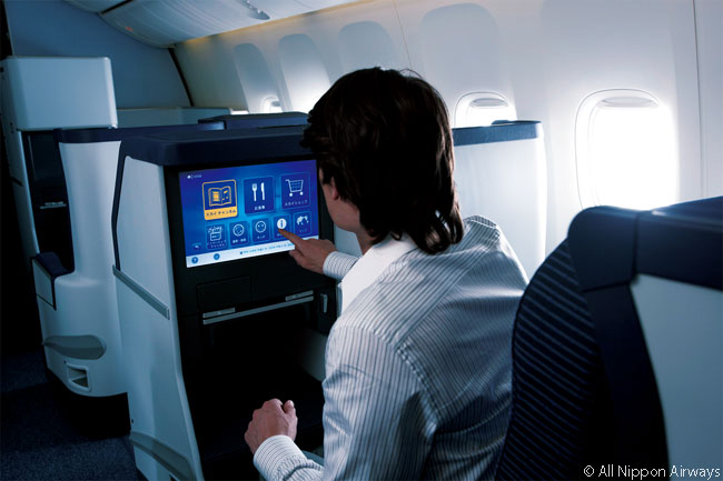 Passengers in ANA's Being 787 business class cabins have 12.1-inch seatback LCD video touch-screens, on which their in-flight entertainment choices play