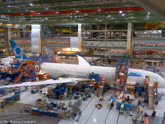 Boeing began final assembly of the first 787-9 on May 30, 2013. This side view shows the longer fuselage sections that are characteristic of the second member of the 787 family. The vertical stabilizer on the first flight-test 787-9 reflects the new Boeing Commercial Airplanes livery