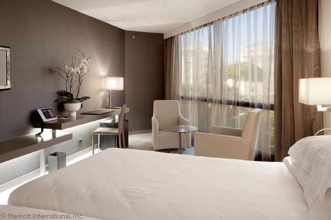 This photo shows the clean lines of the décor in a guestroom in the AC Hotel Nice, in the coastal city of Nice in Provence