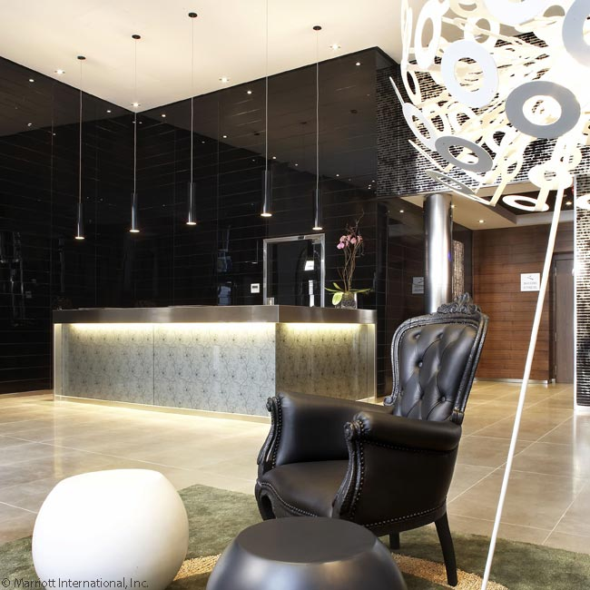 This photograph shows the modern design of the lobby in the AC Hotel Recoletos in Madrid