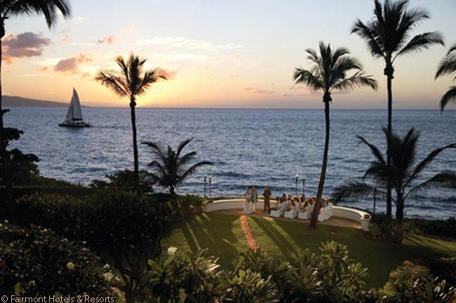 The Fairmont Kea Lani on Maui has 22 acres of grounds in which  hibiscus and bougainvillea grow amidst green grass. The grounds, which also feature small waterfalls and ponds, are a popular place for weddings, as this photograph shows