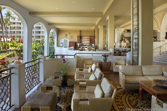 On the oceanward side of the Fairmont Kea Lani's lobby open-air seating is the Luana Lounge, an attractive space overlooking the resort's grounds through archways open to the outside air