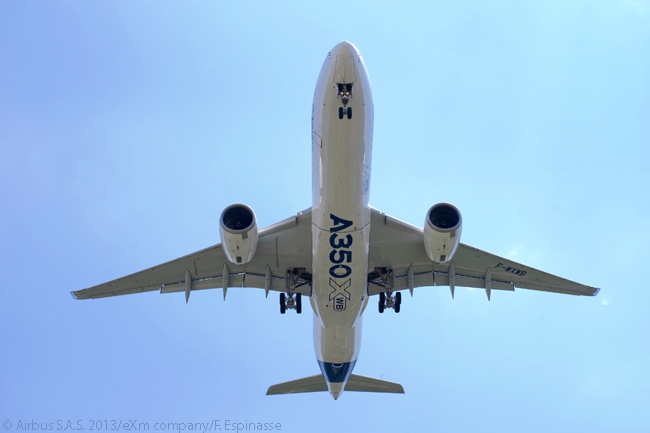 This interesting photograph was taken from below the flight path of the first flight-test A350 XWB just before it landed following its maiden flight, on June 14, 2013. Note the big 'A350' painted on the bottom of the fuselage: perhaps in preparation for a flypast at the Paris Air Show the following week?