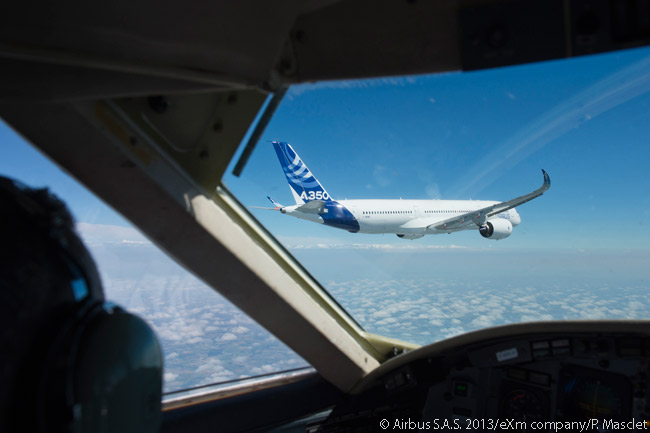 This is a photograph of the first flight-test A350 XWB at altitude during its maiden flight, with its gear retracted. The aircraft was being photographed from a chase plane accompanying it throughout the first flight