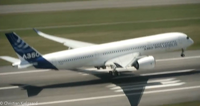 This photograph, captured from a video shot from a nearby helicopter, shows another angle of the first A350 XWB landing after its maiden flight on June 14, 2013