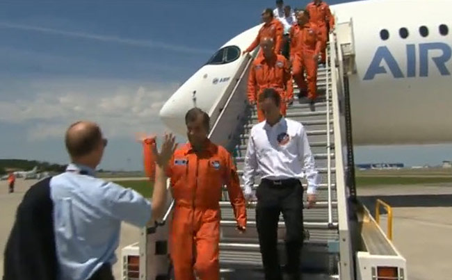 Airbus officials congratulate the six-man flight-test crew of A350 XWB MSN1 as they disembark the aircraft following its successful first flight on June 14, 2013