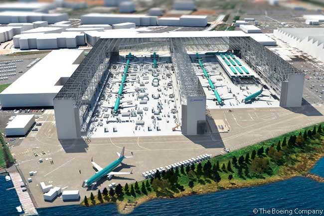"Boeing plans to begin production of the first 737 MAXs, to be used for flight testing, in 2015. Pictured here is an artist's rendering of Boeing's 737 production line in Renton, Washington, with capital investments in place to support production at a rate of 42 aircraft a month and the introduction of the 737 MAX. The 737 MAXs will be built on a ""proving line"" in between the two main production lines to the left and the right. The 737 MAX 8 will be the first variant produced, with the first four aircraft to be part of the flight test fleet. The team plans to install flight test equipment on the jets during production to save time"