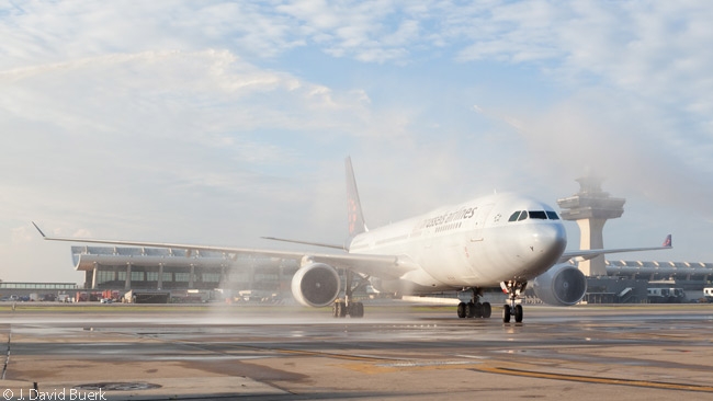 The Airbus A330-200 which operated Brussels Airlines' inaugural Brussels-Washington Dulles flight on June 18, 2013 receives a traditional water salute from two Washington Dulles International Airport fire engines as it taxis in towards its gate after landing. The photograph is courtesy and copyright of J. David Buerk