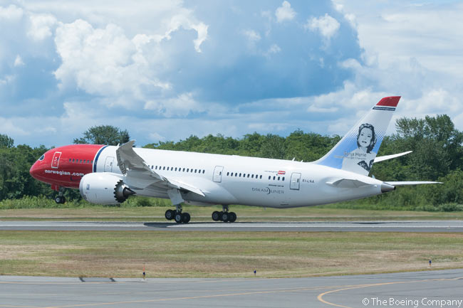 Aircraft lessor International Lease Finance Corporation (ILFC) and Norwegian celebrated several milestones on June 27, 2013 during a delivery ceremony for a new Boeing 787. It was the first 787 delivered to ILFC and its lessee, Norwegian, which is operating the aircraft. The 787 was alsothe 700th commercial jet Boeing had delivered to ILFC. This photo shows the aircraft during one of its pre-delivery production test flights. The portrait on the tail of the aircraft is of Sonja Henie, a Norwegian who was a world-famous figure-skating champion and film star