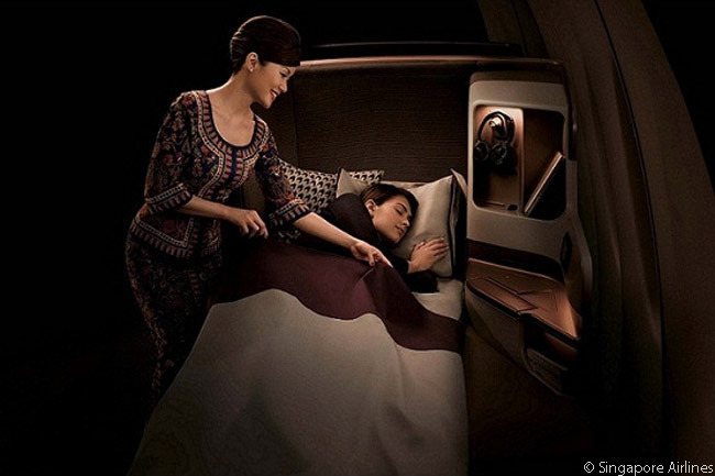 When converted to a flat bed, SIA's latest Business Class seat becomes the industry's widest full-flat bed and is 78 inches in length, according to the airline. The seat also features a padded headboard cushion for extra comfort