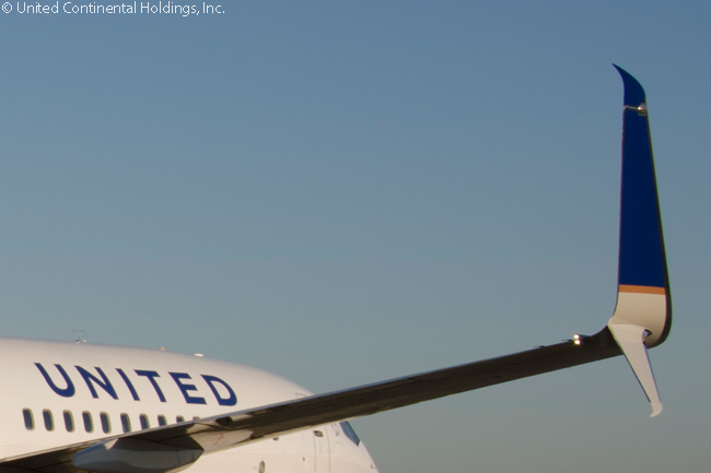 "United Airlines' program to retrofit its Boeing 737-800s and 737-900ERs with split scimitar winglets consists of replacing each existing blended winglet aluminum winglet tip cap with a new aerodynamically shaped ""Scimitar"" winglet tip cap and adding a new Scimitar-tipped ventral strake"