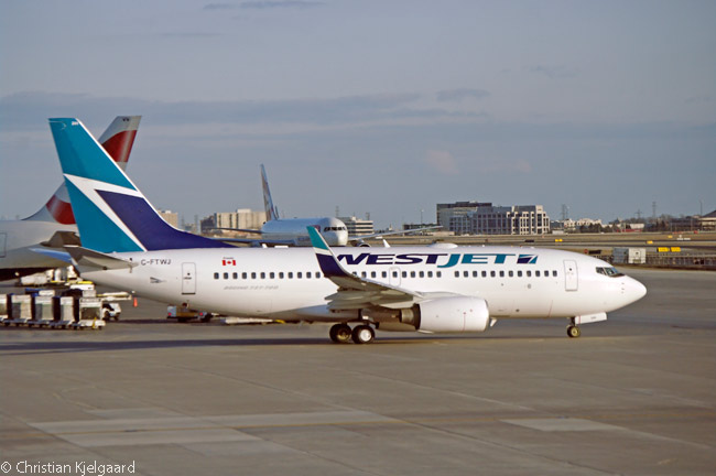 A WestJet Boeing 737-700 taxis out from its Terminal 3 gate at Toronto Pearson International Airport