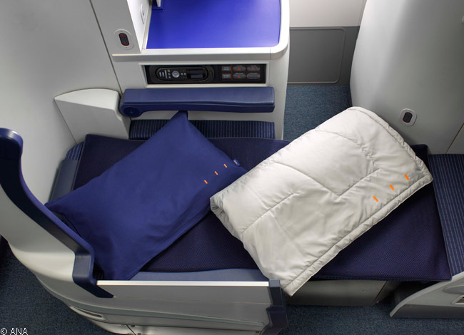 From September 2013, ANA began offering bed pads on its long-haul Business Class seats for the first time. The pads were available for the Business Staggered seats installed in ANA's Boeing 787-8s and 777-300ERs