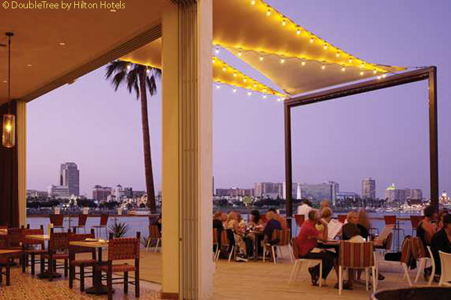 The outdoor patio of the restaurant Fuego at the Hotel Maya seats 80 people and has wonderful views of the harbor and skyline of Long Beach