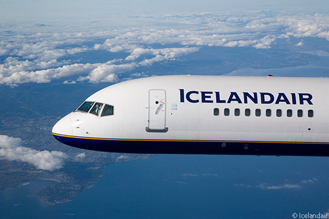 During this air-to-air photo shoot, the captain of this Icelandair Boeing 757-200 is seen waving to the people in the chase plane
