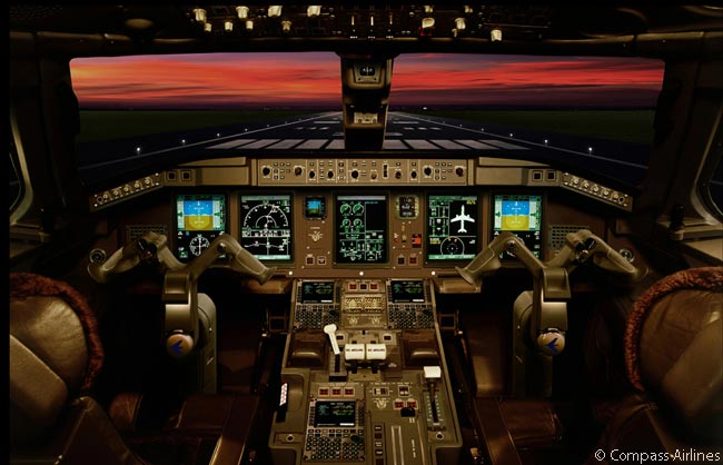 This is the flight deck of a Compass Airlines Embraer 170