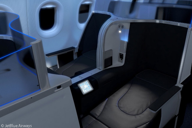 This photograph shows the lie-flat seats that JetBlue Airways developed for its busiest U.S. transcontinental routes, for installation in Airbus A321s. Four of the 16 seats are in single suites with closable doors