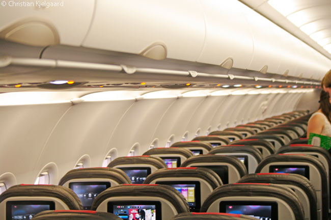 Gray, red and cream are the dominant color notes in the economy-class cabin of the Airbus A319 in American Airlines service