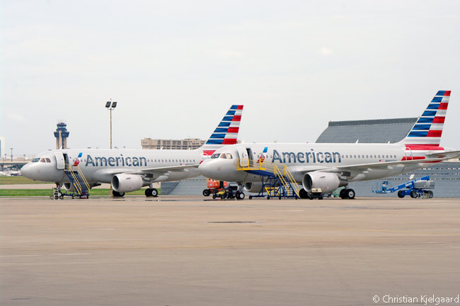 Resplendent in American Airlines' new livery, the second and third Airbus A319s delivered to the carrier sit on the ramp outside American's Hangar 5 at Dallas/Fort Worth International Airport on August 14, 2013