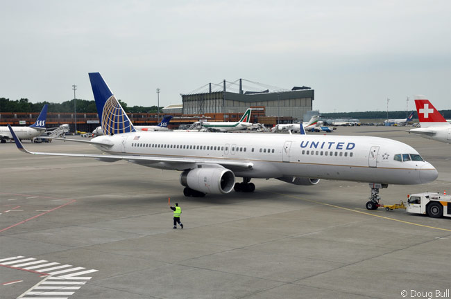 United Airlines Boeing 757-200 N19117 pushes back from a gate at Berlin-Tegel Airport