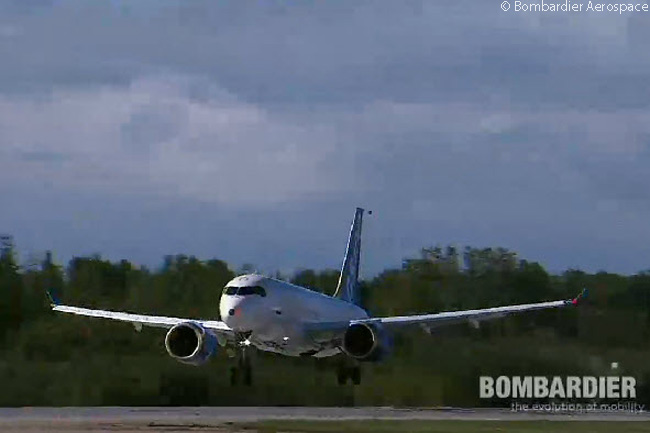 The first Bombardier CS100, which Bombardier calls Flight Test Vehicle One (FTV1) and is registered C-FBCS, takes off for the first flight of the Bombardier CSeries family on September 16, 2013, at 9:53 a.m. This still photograph was captured from the official live video feed of the CSeries' maiden flight webcast by  Bombardier Aerospace