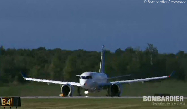 Bombardier CS100 FTV1 begins its take-off run for its maiden flight on September 16, 2013, at Mirabel Airport near Montreal. This still photograph was captured from the official live video feed of the CSeries' maiden flight webcast by  Bombardier Aerospace