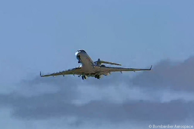 The Bombardier Global 5000 chase aircraft following Bombardier CS100 FTV1 takes off at 9:50 a.m. on September 16, 2013 in advance of the new CSeries airliner in order to be in the air when the first CSeries takes off for its maiden flight. This still photograph was captured from the official live video feed of the CSeries' maiden flight webcast by  Bombardier Aerospace