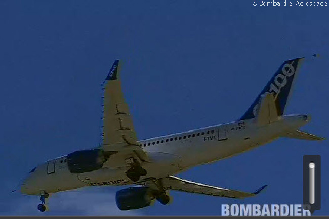 Bombardier CS100 C-FBCS performs a slow flypast at Mirabel Airport minutes before it landed safely following its maiden flight, the first flight of any CSeries jet. This still photograph was captured from the official live video feed of FTV1's first flight webcast by Bombardier Aerospace