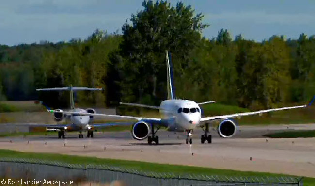 Its Bombardier Global 5000 chase plane still following behind, CS100 FTV1 taxis in towards the Bombardier Aerospace facilities at Mirabel Airport following its successful first flight. This still photograph was captured from the official live video feed of FTV1's first flight webcast by Bombardier Aerospace