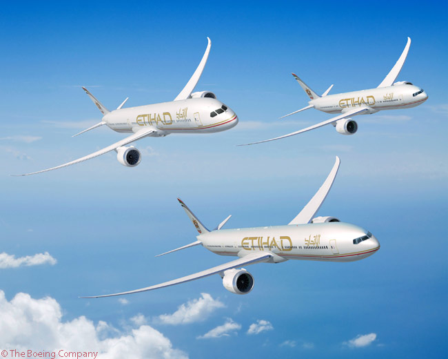 This computer graphic image shows how the Boeing 777-9X (foreground, 787-10 (upper left) and 777-8X (upper right) will look in Etihad Airways' colors
