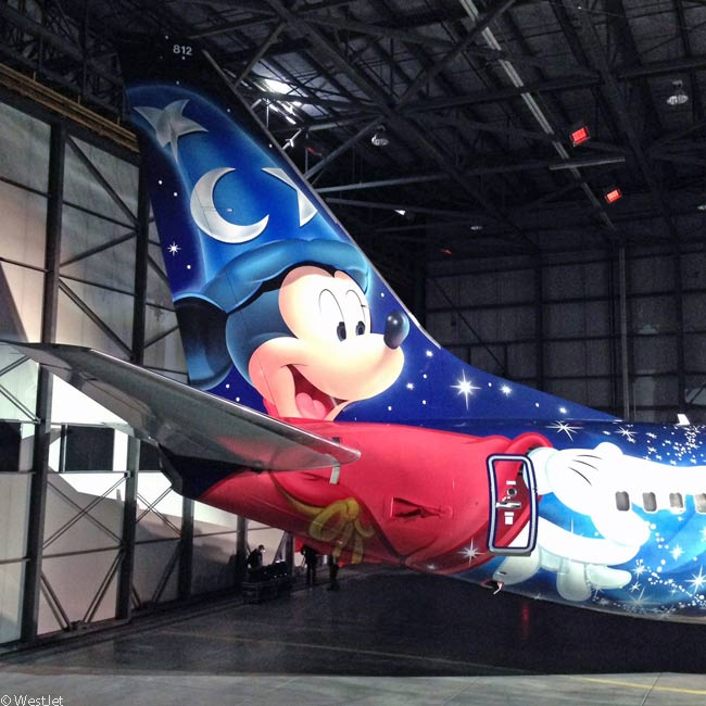 WestJet calls its first Disney theme-painted aircraft the #MagicPlane. The most prominent feature of the livery is a painting of Mickey Mouse as Sorcerer Mickey on the tail of the aircraft