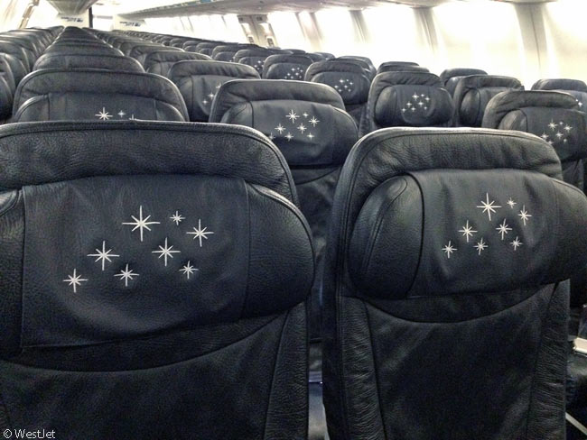 The interior of WestJet's Disney-themed Boeing 737-800 features head-rest covers with stars on them