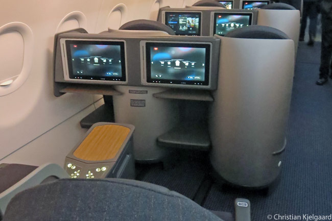 The Business Class flat-bed seats in American Airlines' A321 Transcontinental aircraft are arranged in a two-by-two seat-row configuration. No Business Class window seat has direct access to the aisle, but all seats have 15.4-inch-diameter, tilting, touchscreen in-flight entertainment screens