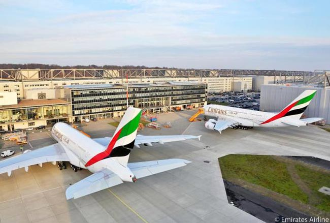 On the weekend of December 21-22, 2013, Emirates Airline took delivery of two new Airbus A380s (numbers 43 and 44 for the airline) on the same day. The aircraft are seen here at Airbus' A380 completion center at Finkenwerder Airfield in Hamburg, where Emirates took delivery of the two aircraft