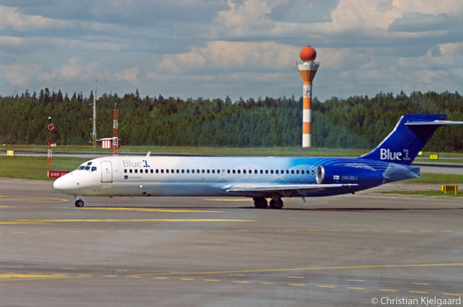 Blue1, the Finnish subsidiary of SAS AB, operates nine Boeing 717s for the SAS network. This Blue1 Boeing 717 is taxiing from its gate at Helsinki-Vantaa Airport's Terminal 1 out towards the take-off runway