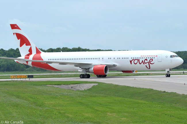 An Air Canada rouge Boeing 767-300ER turns on to the runway for take-off at Toronto Pearson International Airport