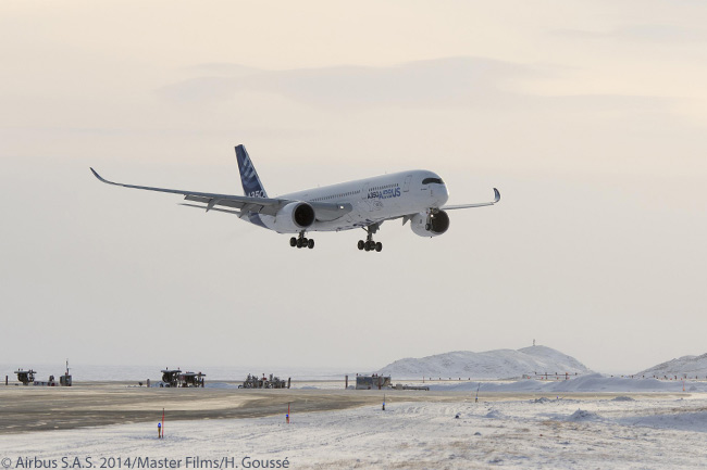 Airbus A350-900 MSN3, the second flight-test A350-900, is photographed on final approach to landing at Iqaluit Airport in Nunavut territory in northern Canada, to complete a local flight during A350 XWB cold-weather trials at Iqaluit in the extremely cold month of January 2014