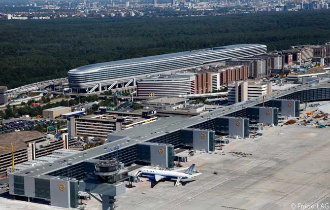 This photograph is dominated by The Squaire office building, in the center of the picture. In the foreground is Frankfurt Airport Terminal 1's new, two-level Pier A Plus, which is almost 1 mile long. Unfortunately, most flights from New York JFK park at Gate A/Z69, which is the farthest gate to the left of the picture and is a walk of fully 1 mile to Terminal 1's immigration and customs facilities