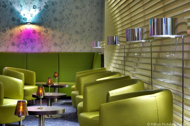 At the back of the Hilton Frankfurt Airport's FIFTH Bar & Lounge is a colorful, very stylish area in which to have a drink and, if so minded, watch a sporting event on television