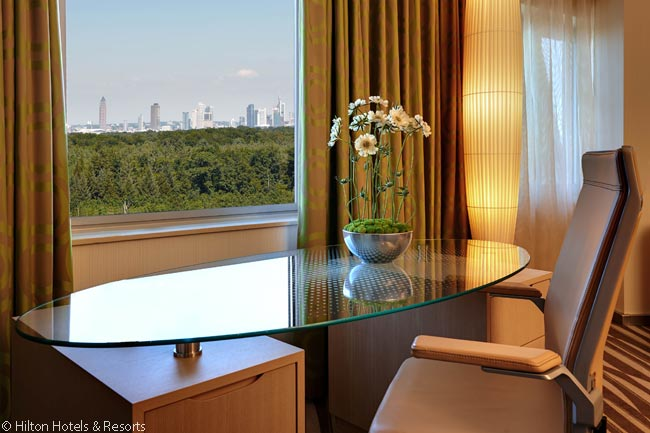 The guestrooms and suites on the northern side of the Hilton Frankfurt Airport look out on to the Frankfurt City Forest conservation area, beyond which lies the city of Frankfurt itself. North and west of the city is a range of hills, also clearly visible from the rooms