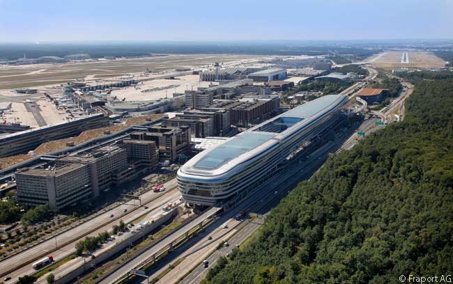 In the foreground of this photograph is the eastern end of The Squaire, a huge, 10-floor 'groundscraper' which is reputedly Germany's largest office building. The near ond of the Squire contains the Hilton Frankfurt Airport and the Hilton Garden Inn Frankfurt Airport. In the distance on the right can be seen Frankfurt Airport's new Runway 25R, used only for landings