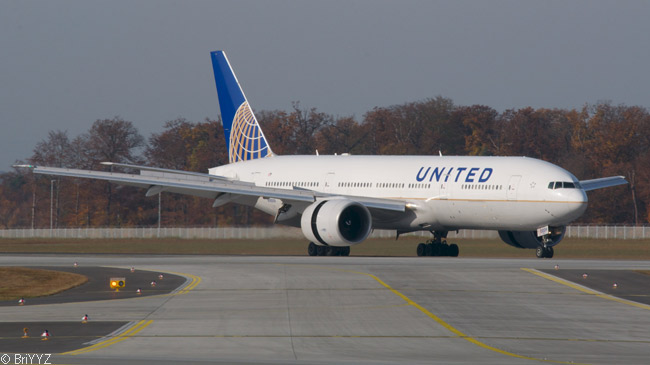 A Continental Airlines-legacy Boeing 777-200ER of United Airlines decelerates upon landing at Frankfurt Airport, using its thrust reversers