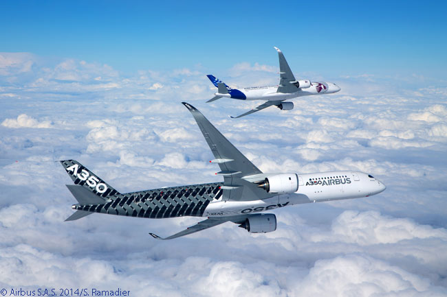 Flight-test Airbus A350-900s MSN2 (nearest the camera) and MSN4 bank away from the chase plane as they fly in formation during their respective maiden flights. Both aircraft flew for the first time on February 26, 2014, doubling to four the number of A350-900s flying in the A350 XWB flight-test program at that time
