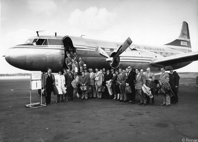 On August 29, 1954, Finnair's predecessor airline Aero Oy operated its inaugural flight from Helsinki to London Heathrow Airport. This photograph shows the Convair 340 which operated the service, along with all the passengers on the flight
