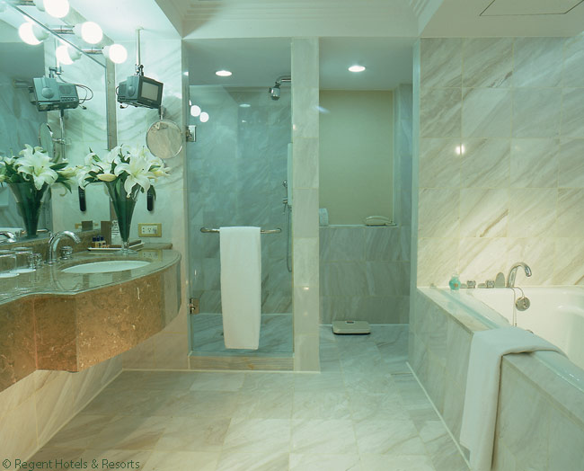 The bathrooms in the suites and guestrooms of the Regent Taipei hotel are lined in marble